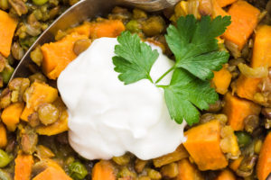 Serve curry lentil stew with sour cream and cilantro