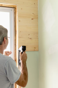 Adding the short shiplap boards to the outsides of windows