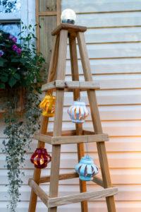Obelisk with lanterns