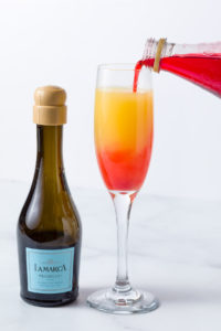 Adding a little Grenadine to my mimosa