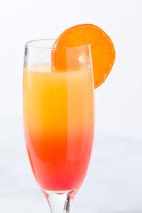 Mimosa with fresh orange slice garnish