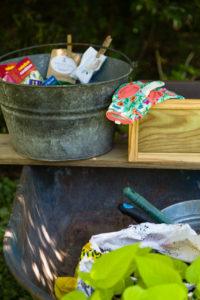 Wheelbarrow setup as a portable potting bench