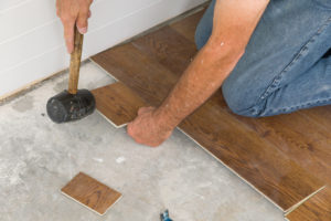 Using a rubber mallet lock the planks in place