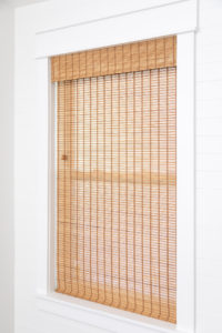 New window with trim and woven wood shade