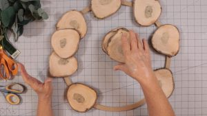 Deciding on the second row of wood slices