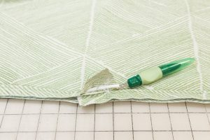 Use a seam ripper to remove a few inches of the stitching