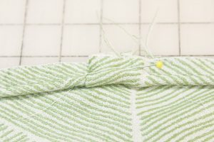 Fold over the bias strip and sew