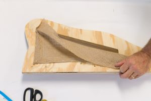 Stapling burlap to wing