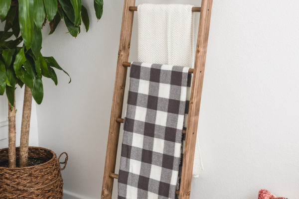 DIY display ladder with throw blankets