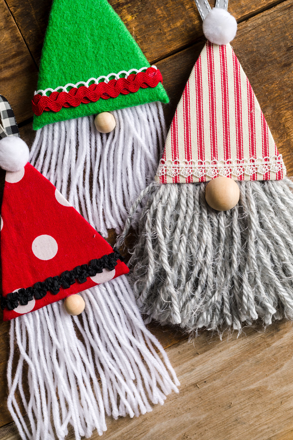 DIY Gnome Christmas Ornaments sitting on a table