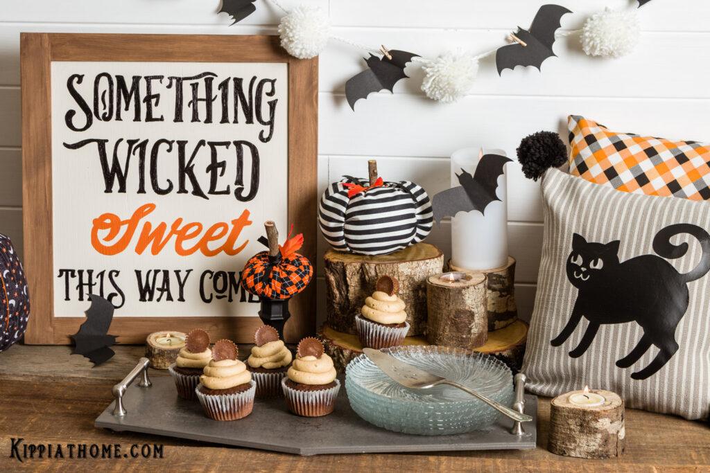 Diy Halloween Sign, fabric pumpkins, pillows, bat banner and peanut butter cupcakes