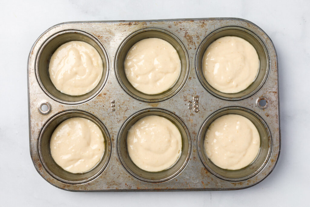 Fill muffin tins with half the muffin batter