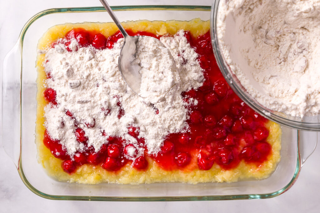 Sprinkle the cake mix mixture over fruit