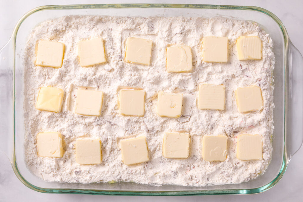 Cover the top of cake mix with pats of butter