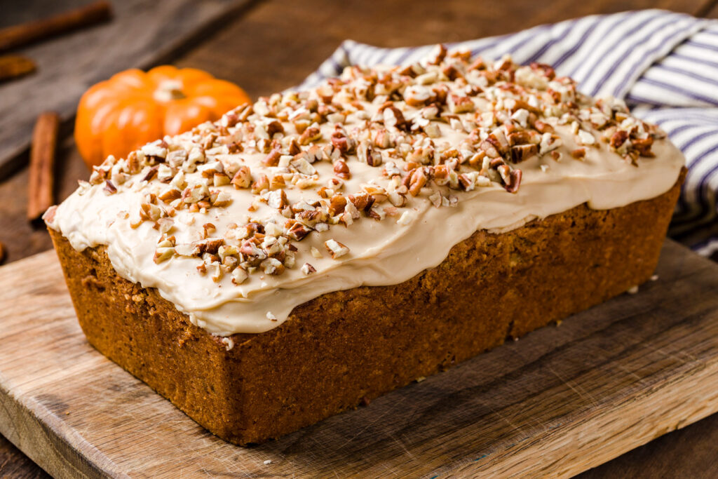Cake with brown sugar frosting and pecans