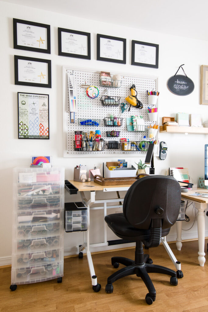 Pegboard wall storage and drafting table after the organization