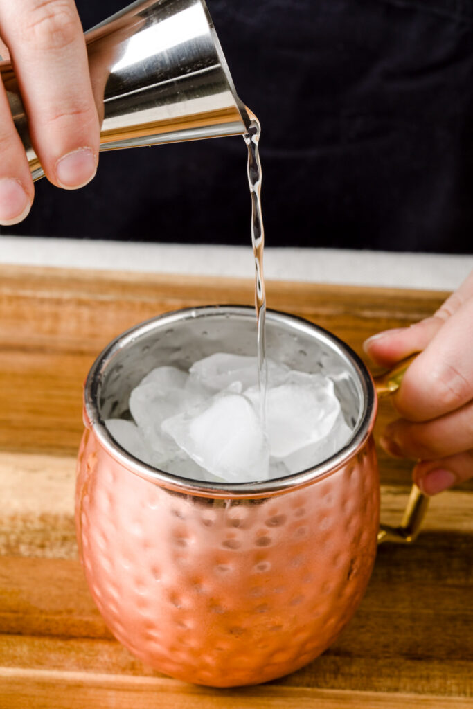 Add vodka to your copper mugs