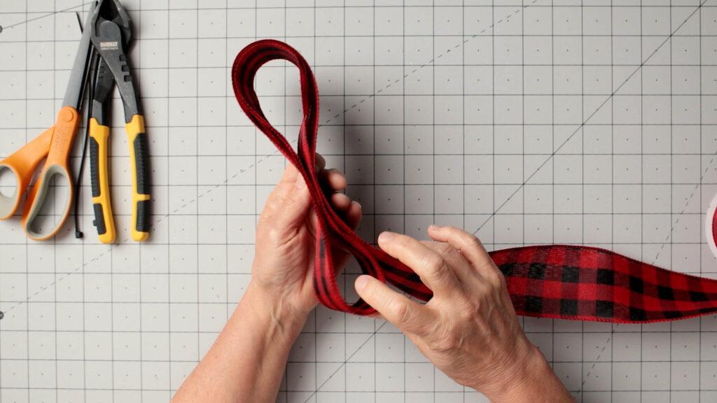 Make three ribbon loops