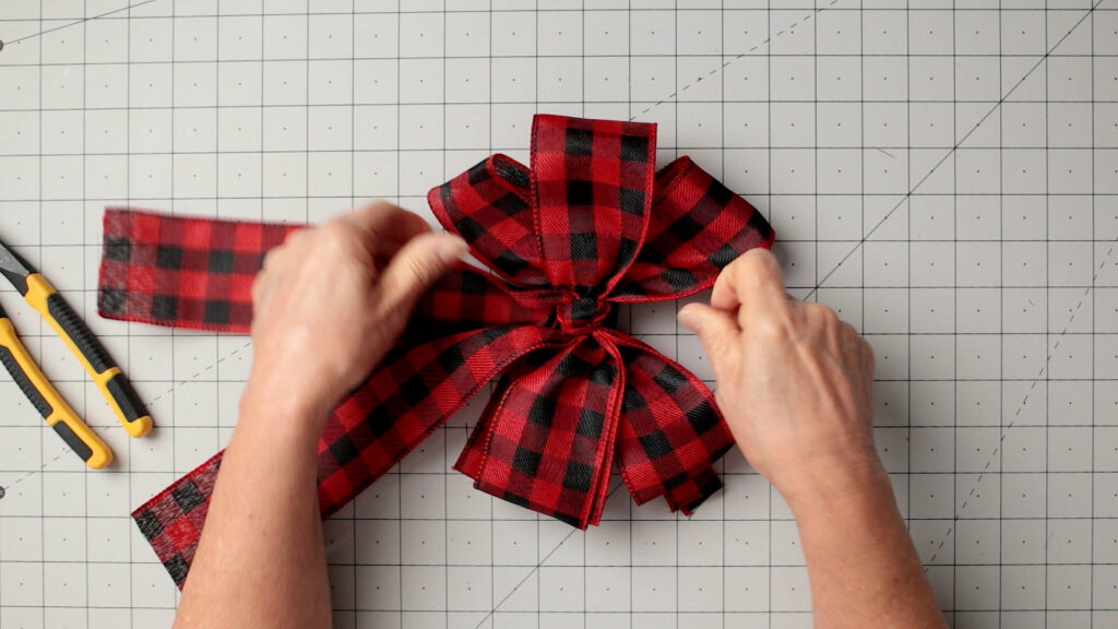 Finish fluffing the wired ribbon bow