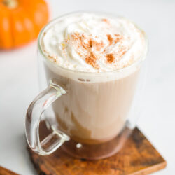 Latte garnished with whipped cream and pumpkin spice