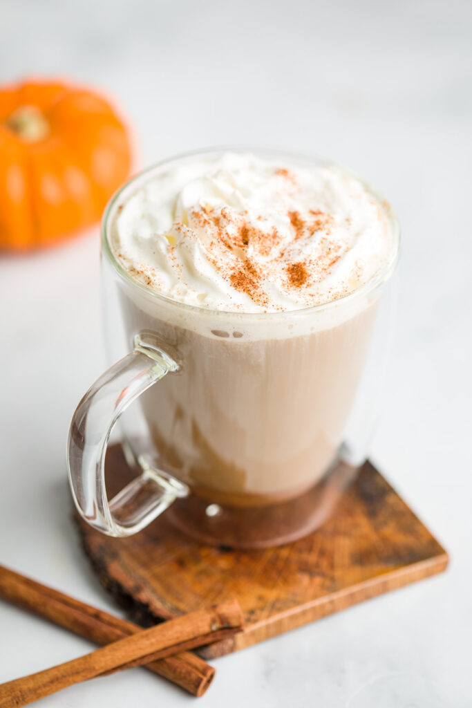 Pumpkin Spice Latte garnished with whipped cream and pumpkin spice