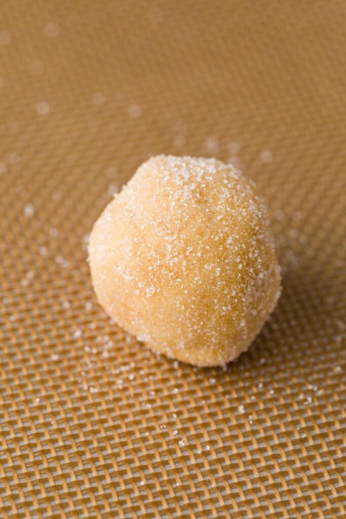 Place sugar coated peanut butter balls on a baking sheet