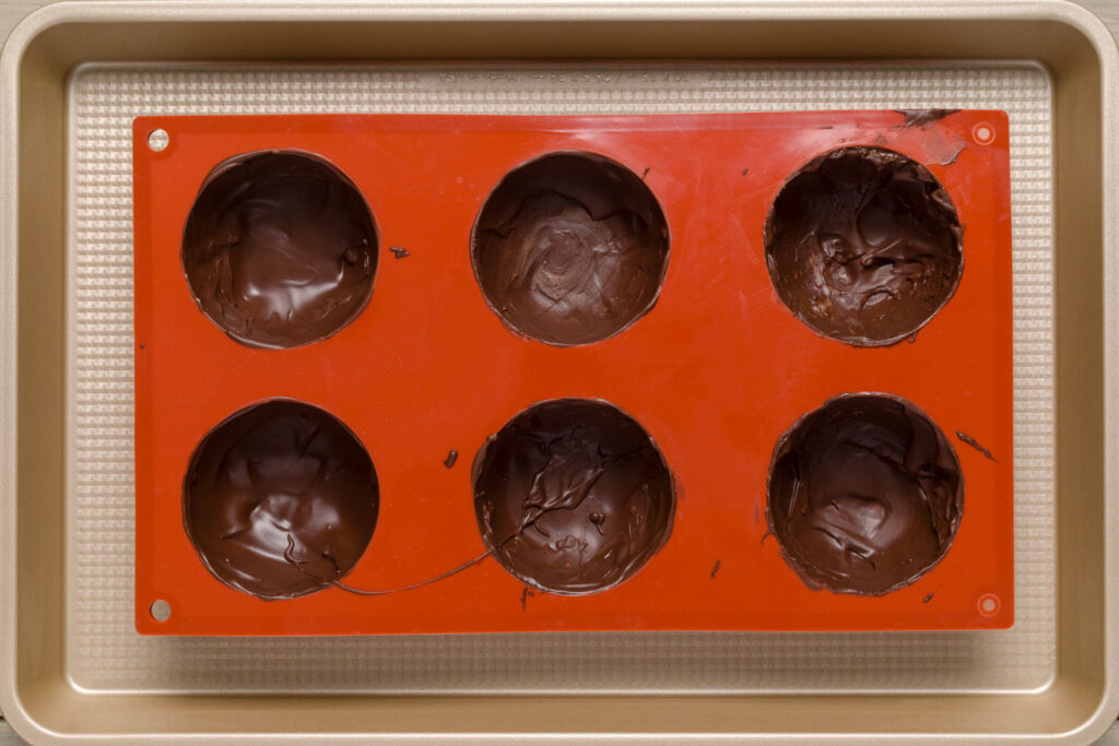 Filled cocoa bomb molds