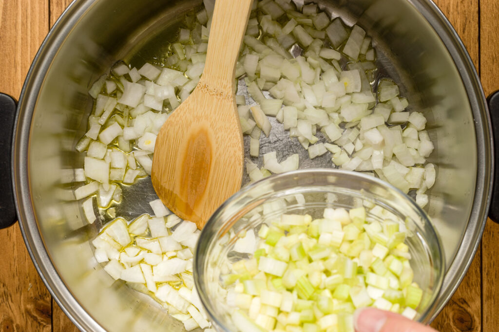 Adding chopped celery