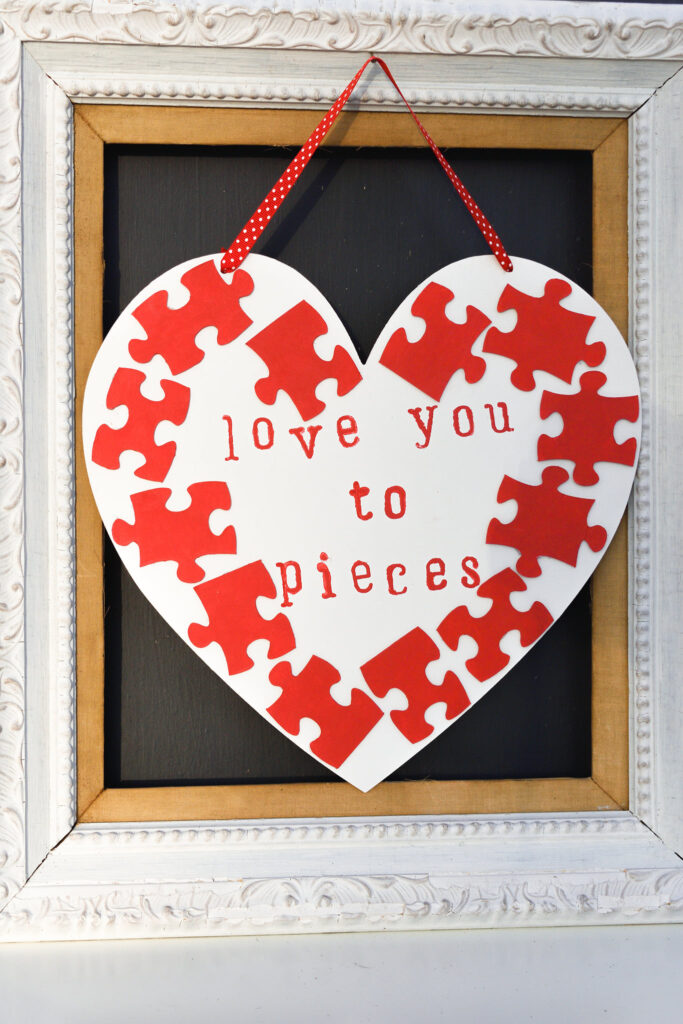 Puzzle piece heart door hanger