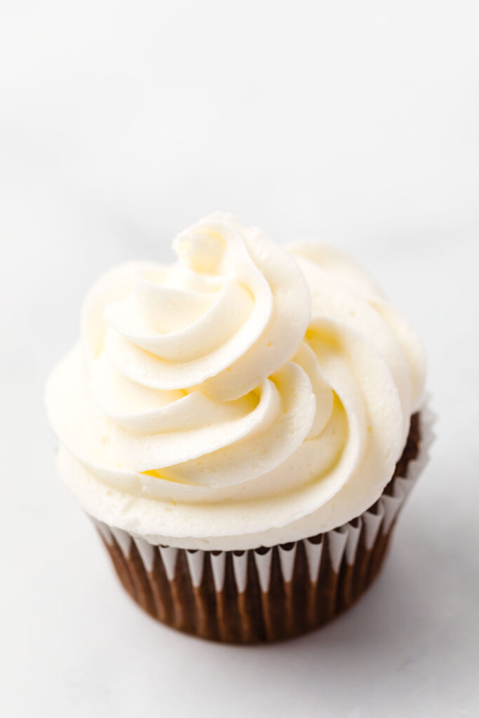 Buttercream frosting on a chocolate cupcake