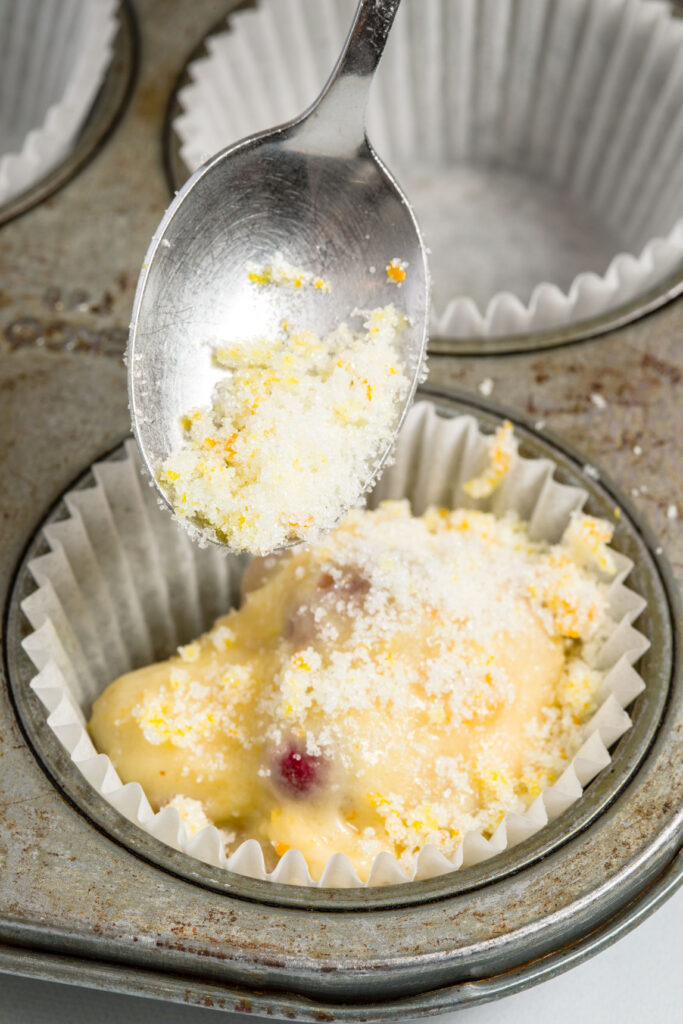 Topping muffins with orange sugar