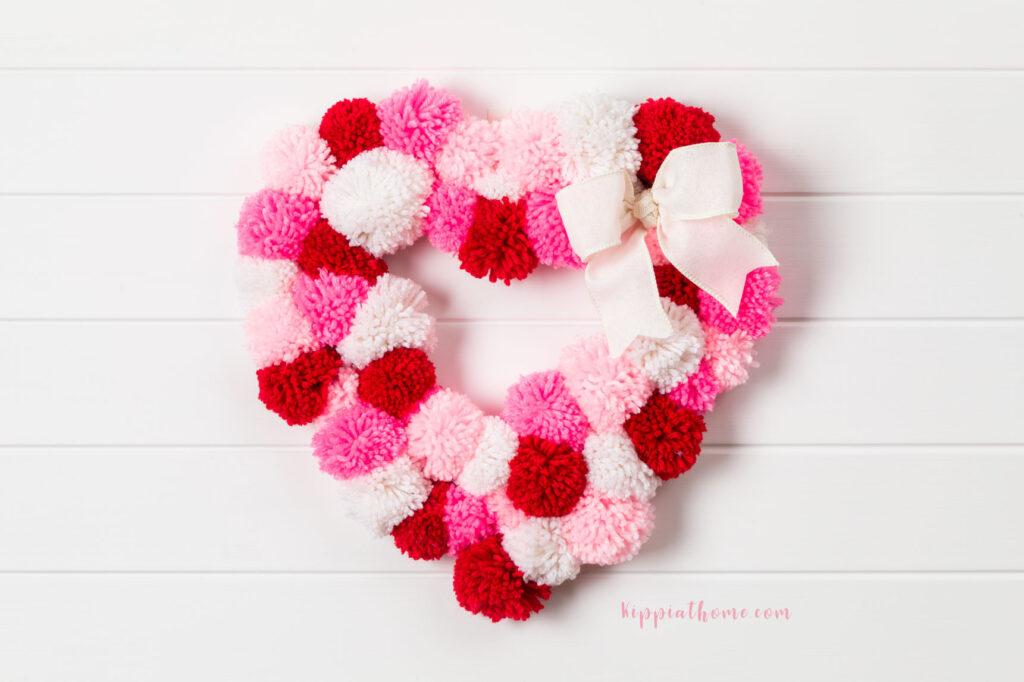 Heart-shaped DIY Valentine's Pom-Poms Wreath