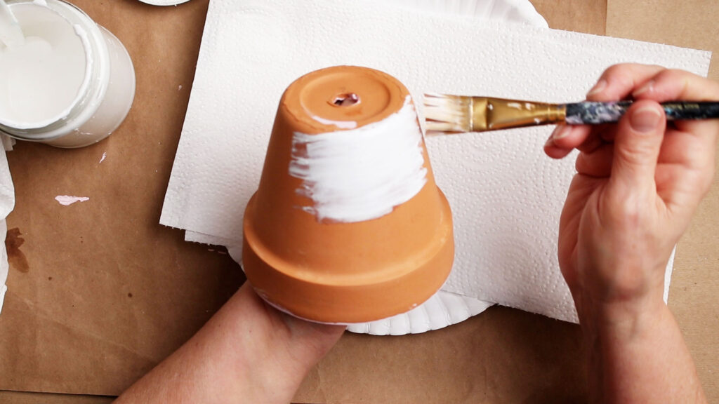 Painting the outside of the terracotta pot