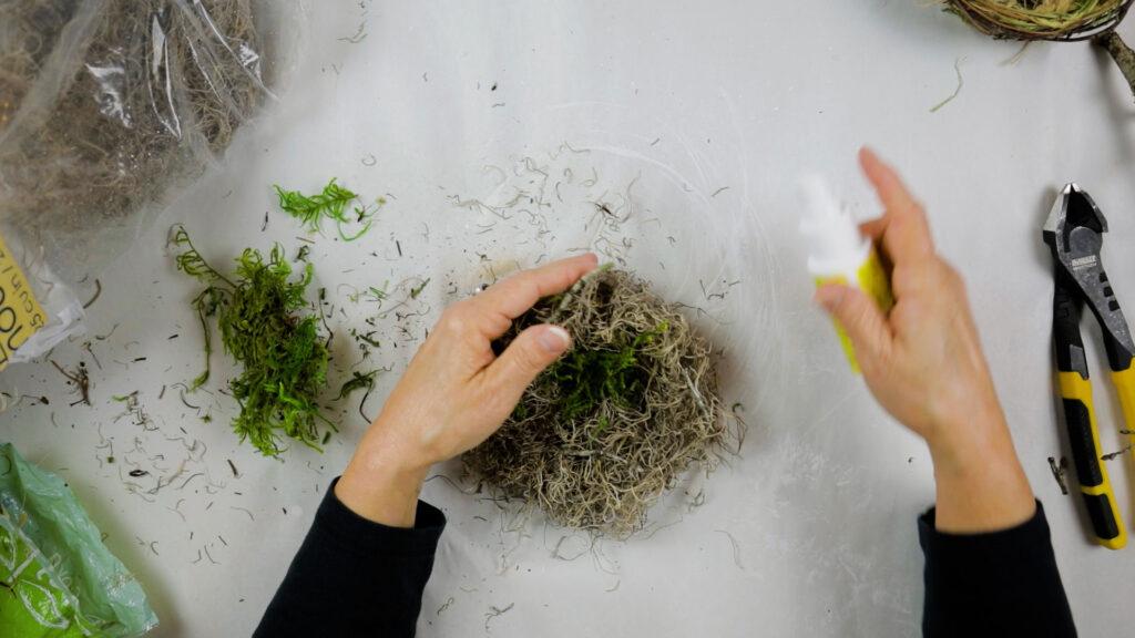 Next, add green moss