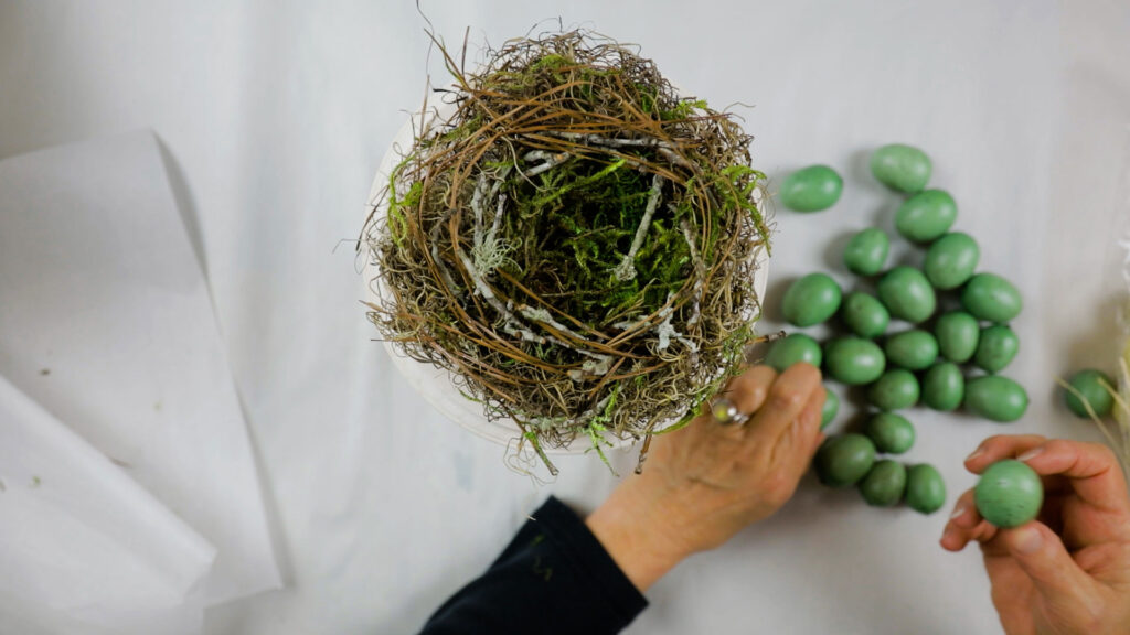 Adding eggs to the nest