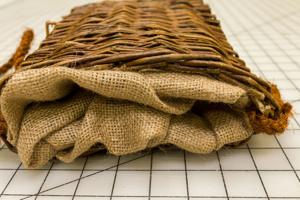 Fold in the extra burlap