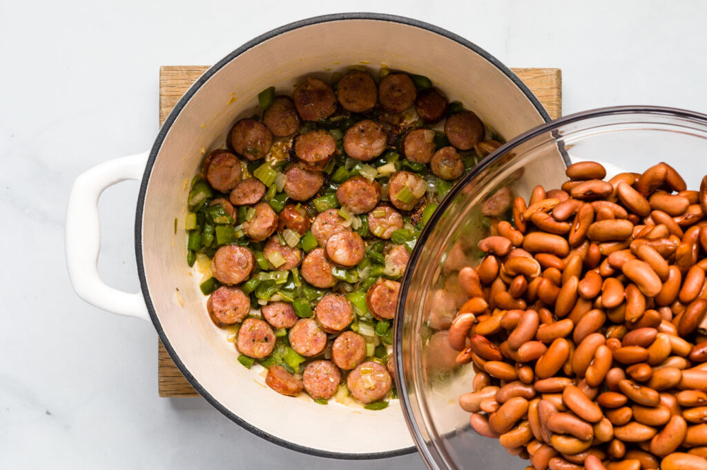 Place beans on the sauteed vegetables and sausage