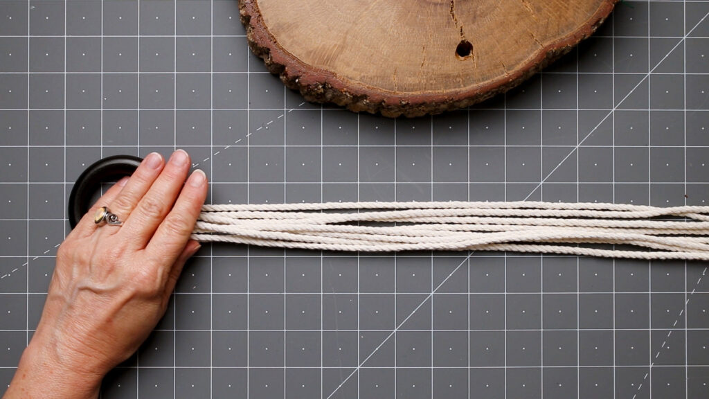 Place the macrame cord through the ring
