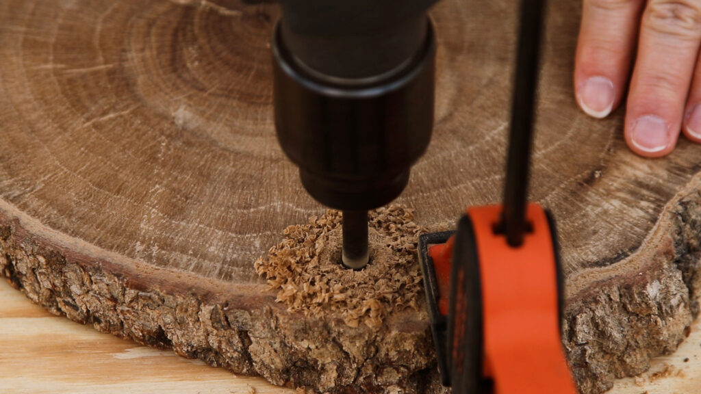 Drill the rope holes through the wood slice