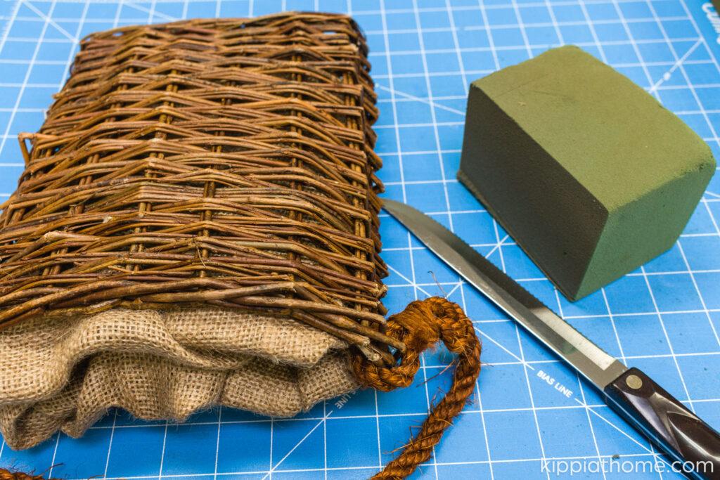 Basket, floral foam, and bread knife