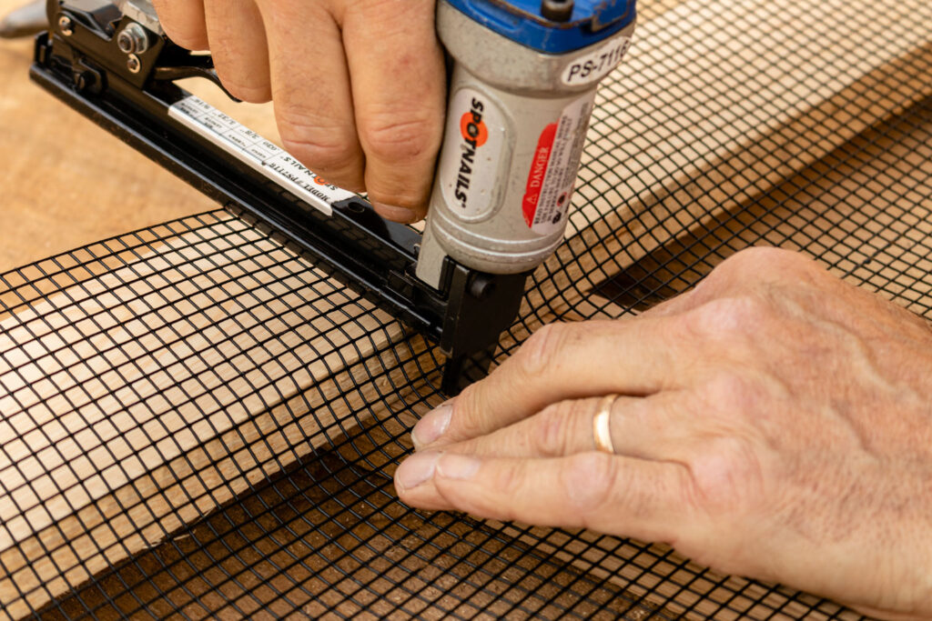Form the hardware cloth to fit tightly against the wood