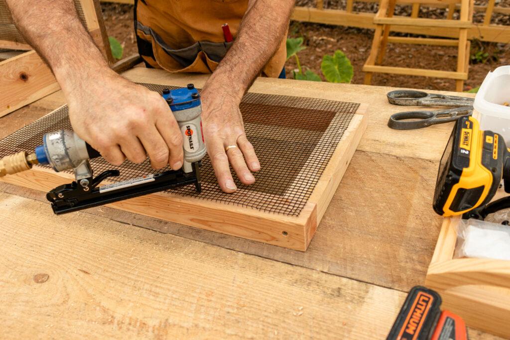 Stapling hardware mesh to door frame