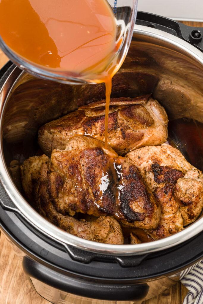 Pour chicken stock mixture over pork