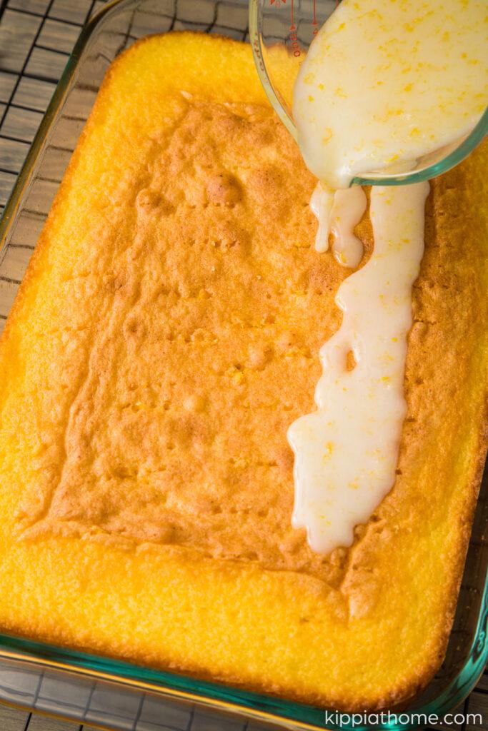 Pour lemon glaze over hot cake