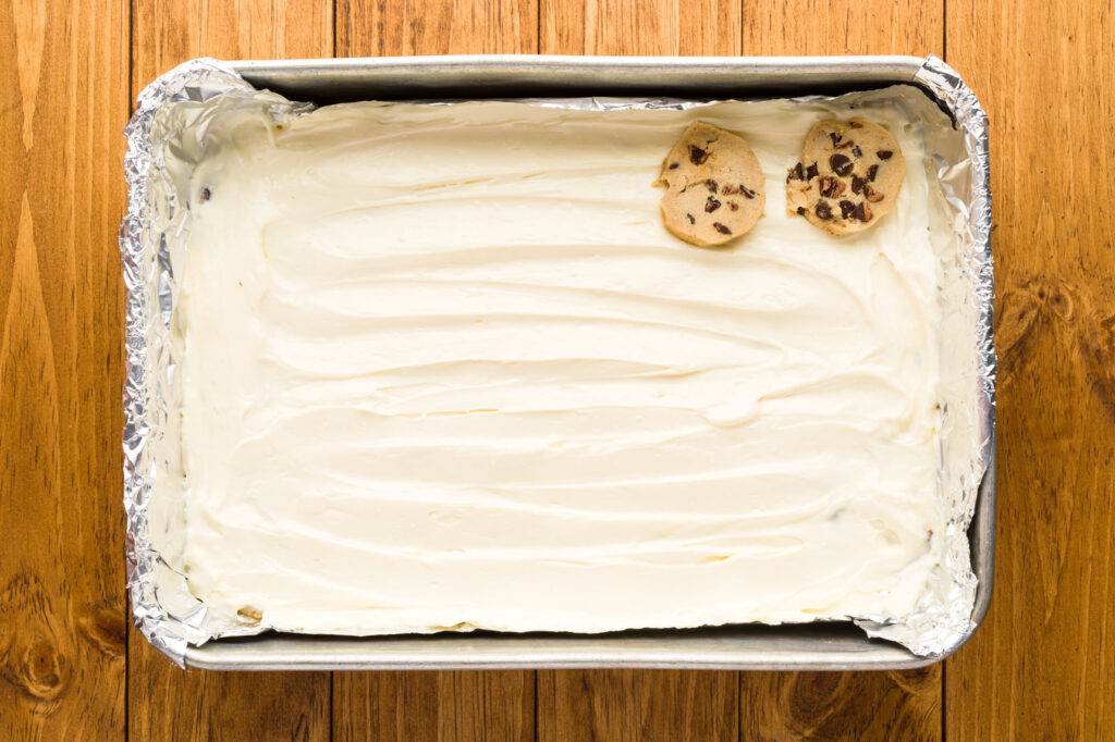 Place sliced cookie dough over the cheesecake layer