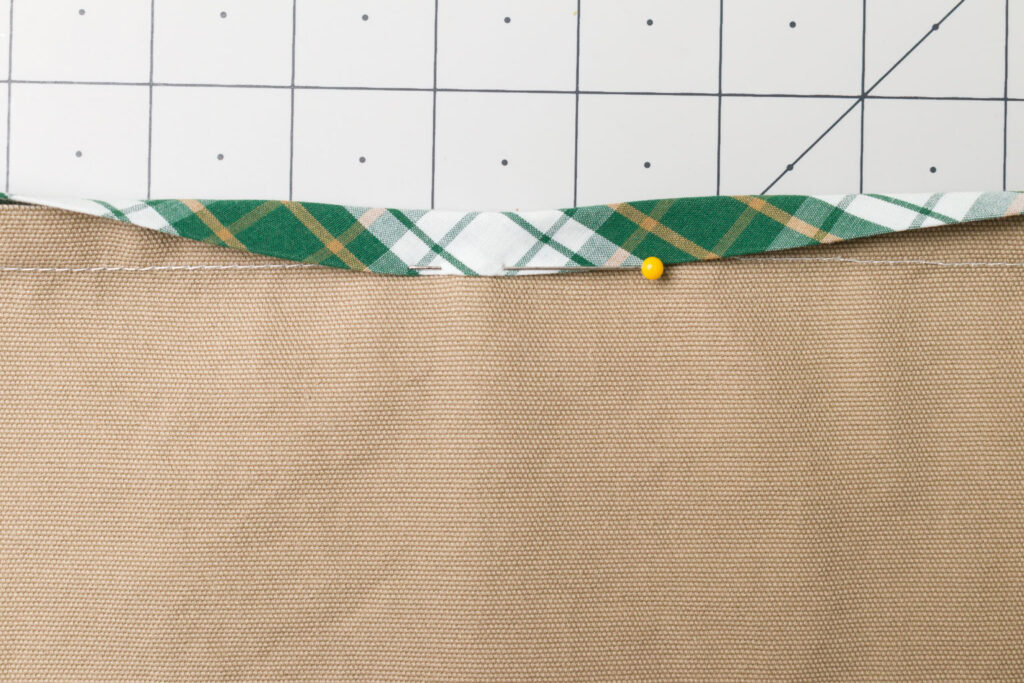 Pin the bias tape to the front side of the pocket