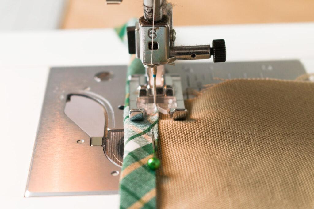 Sew the bias tape close to the edge
