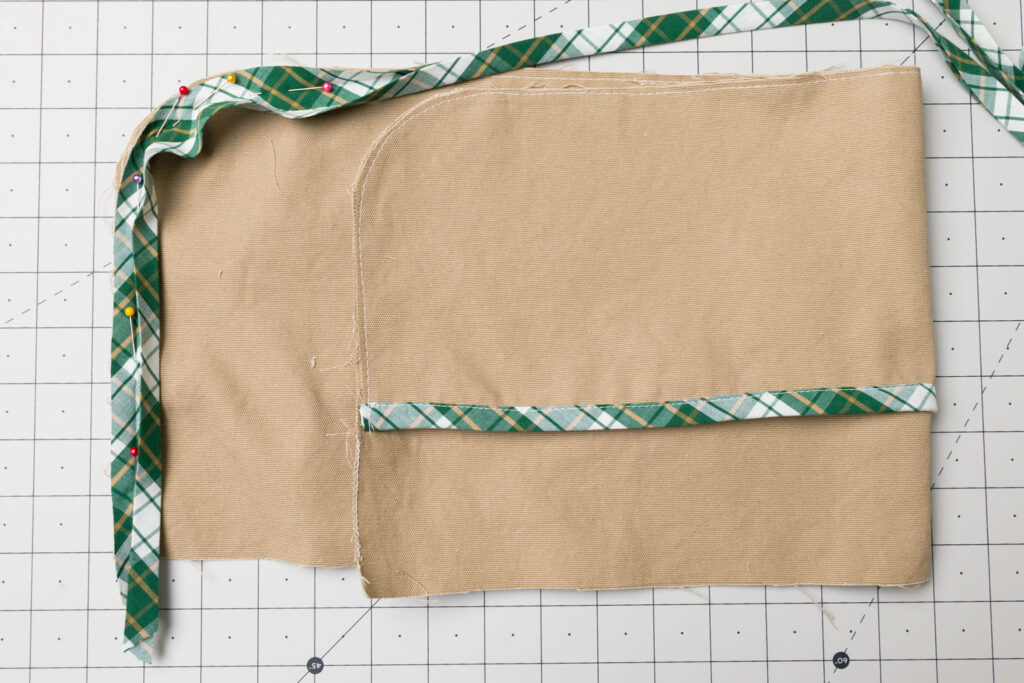 Pin bias tape around the sides and bottom of the apron