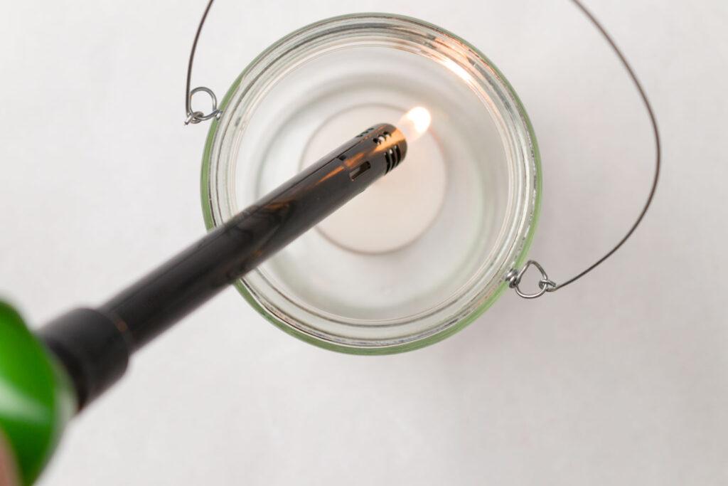 Lighting a tea light