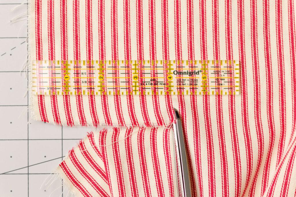 Clip flag fabric at cut marks